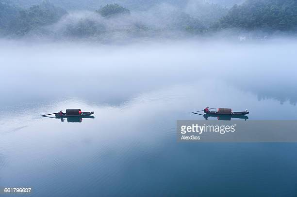 Two traditional boats on river in mist, Chenzhou, Hunan, China
