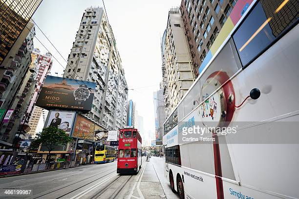 CONTENT] Two traditional doubledecker street trams on tracks in Hong Kong