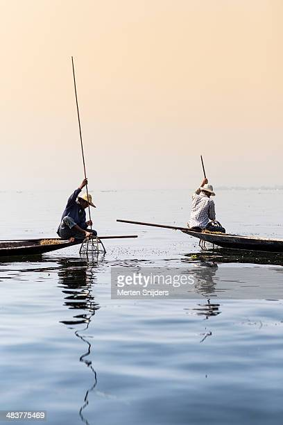 two traditional inle lake fishermen - merten snijders stock pictures, royalty-free photos & images