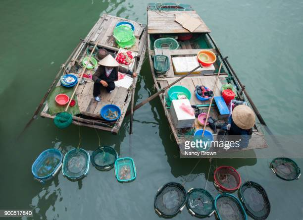 Two Traditional Vietnamese Woman Vendors in Halong Bay Vietnam.