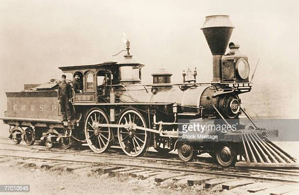 Two train engineeers pose on their steam locomotive number 287 of the Chicago Milwaukee and St Paul railway company which was built in 1860