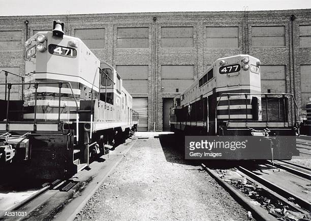 two trains in station (b&w) - cowcatcher stock pictures, royalty-free photos & images