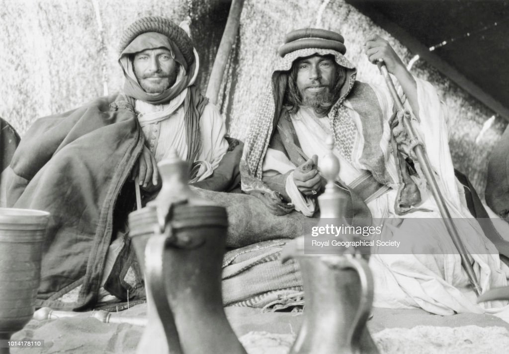 Two tribesmen in a tent at the encampment of Shaikh Auda Abu Tayyi of the Huwaitat : News Photo