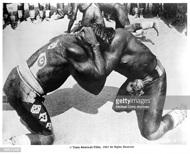 Two tribesmen wrestling for entertainment in their village in a scene from the documentary film 'Macabro' 1967