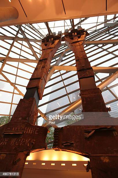 Two tridents from the original World Trade Center loom inside the National September 11 Memorial Museum as the new One World Trade Center rises...