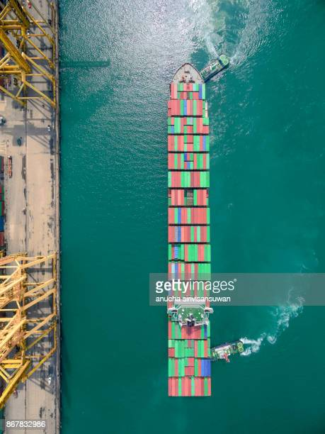 two tug boat towing cargo container in warehouse harbor at thailand . - tugboat stock photos and pictures