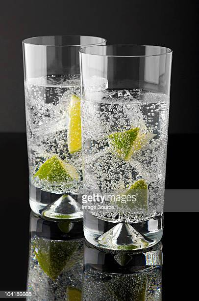 Two tumblers with gin and tonic