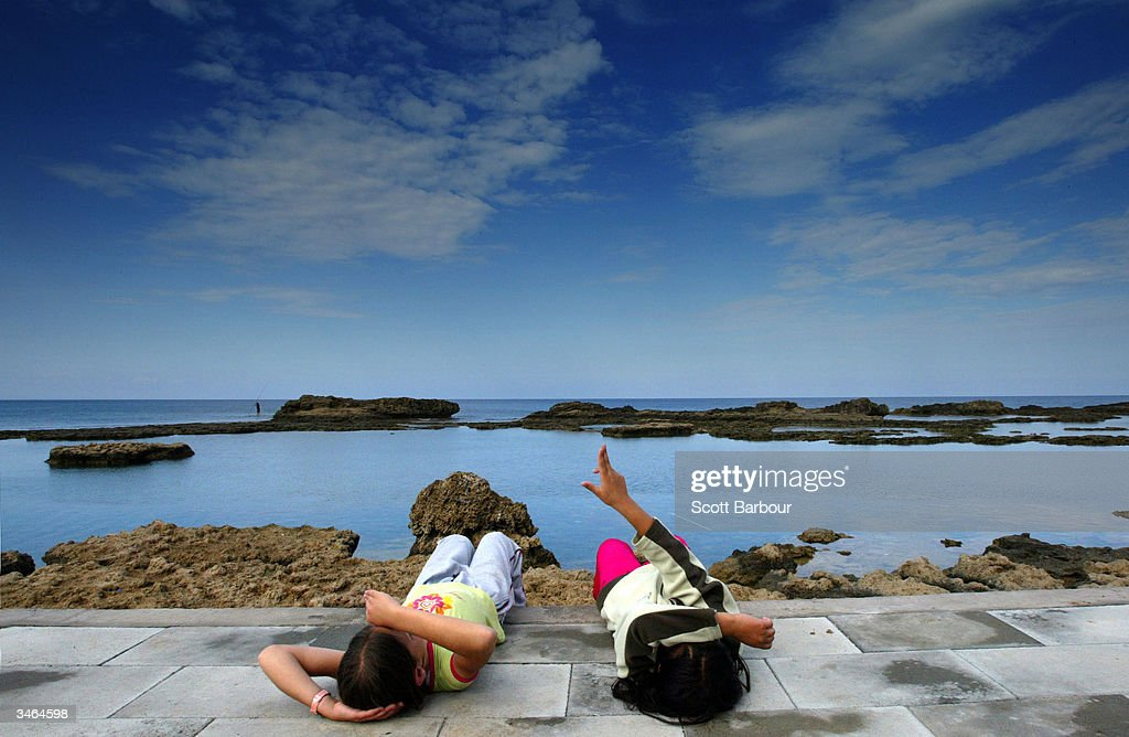 Two Turkish Cypriot children relax by the beach on April 24, 2004 in Famagusta, Cyprus. More than three-quarters of Greek Cypriots have voted against a UN plan after Turkish and Greek Cypriots voted in twin referendums on whether to reunite their island under a federal plan drawn up by the United Nations. Cyprus will become a part of the European Union on May 1 regardless of the result of the vote.
