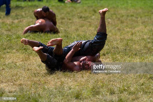 CONTENT] Two Turkish oil wrestler struggle in the arena during the annual tournament known as Kirkpinar in Edirne Turkey