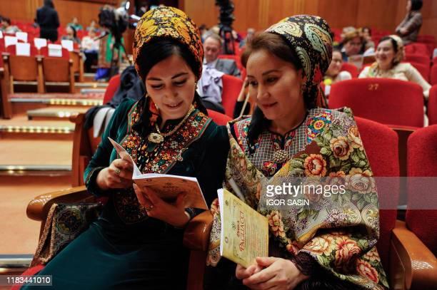 Two Turkmen women wait to watch the premiere of Pagliacci, an Italian opera by Ruggero Leoncavallo directed by Danielle De Plano, at the Makhtumkuli...