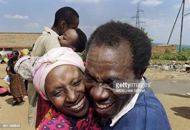 Two Tutsi couples are reunited 13 June 1994 in Kabuga on the outskirts of Kigali after having been evacuated by United Nations soldiers from the...