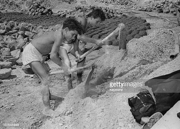 Two twelveyearold boys at work at a sulfur mine in Caltanissetta Sicily 8th October 1952