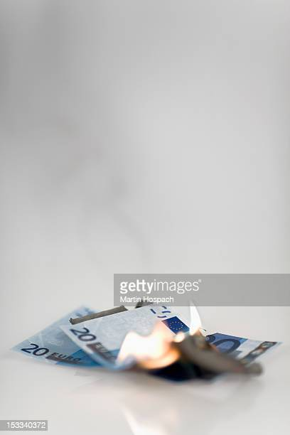 Two twenty euro banknotes on fire