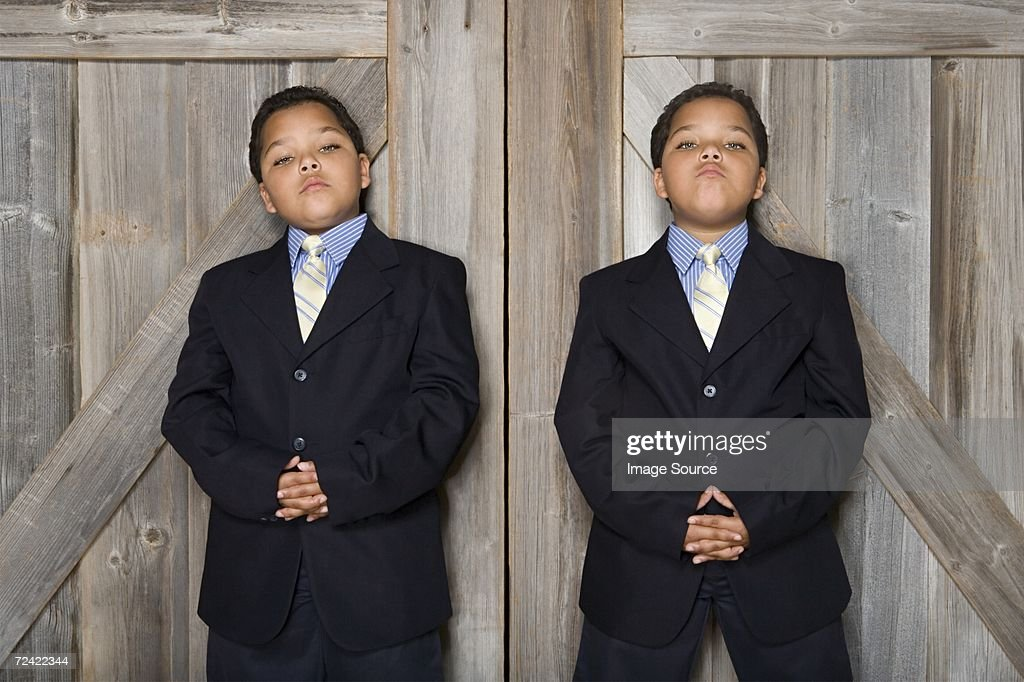 Two twin boys wearing suits : Stock Photo