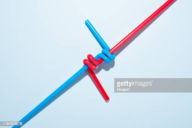 two twisted drinking straws - two objects stock pictures, royalty-free photos & images