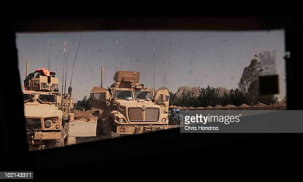 Two types of mineresistant MRAP vehicles including an MATV the heavilyarmored successor to the Humvee are seen through the window of another MATV...