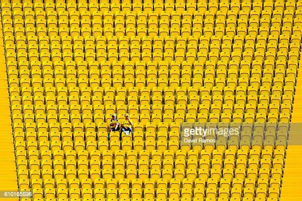 Two UD Las Palmas supporters sit on the stand prior to the La Liga match between UD Las Palmas and Real Madrid CF on September 24, 2016 in Las...