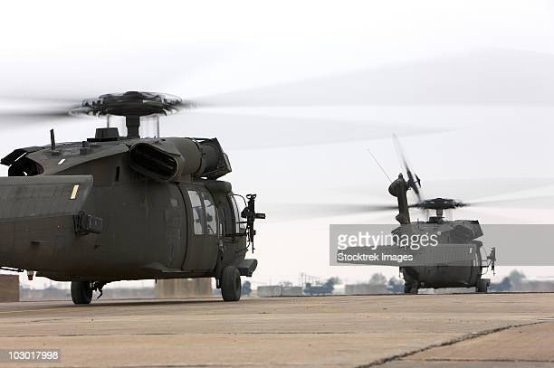 Two UH-60 Black Hawks taxi out for a mission over northern Iraq.