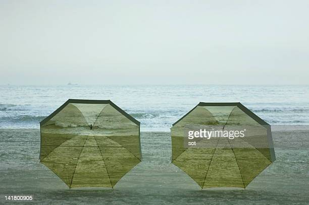 Two umbrellas putting in the beach