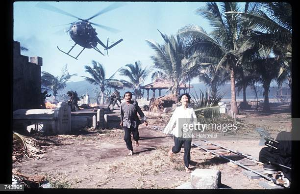Two unidentified actors run April 28 1976 during the filming of 'Apocalypse Now' in the Philippines The movie was directed by Francis Ford Coppola...