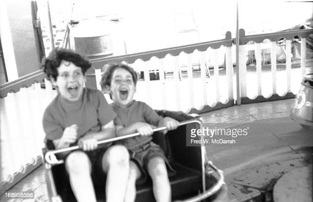 Two unidentified children shout on a ride at an amusement park in Coney Island New York New York May 30 1970