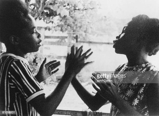 Two unidentified children slap hands as they play 'patacake' a clapping game on Johns Island South Carolina 1974