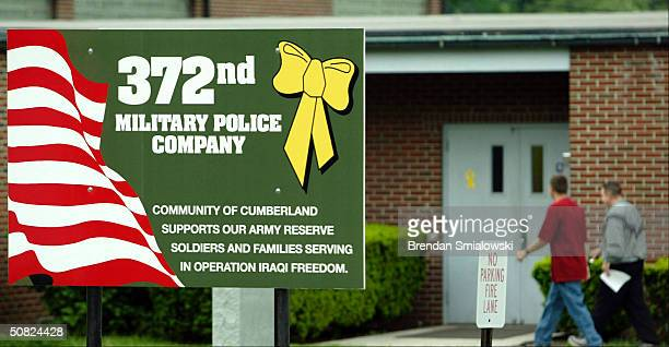 Two unidentified individuals enter the US Army Reserve post May 11 2004 in Cumberland Maryland Cumberland is home to the 372 Military Police Company...