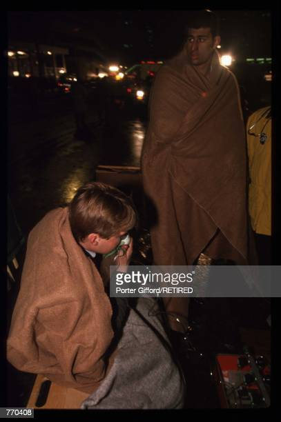 Two unidentified injured men are wrapped in blankets outside the World Trade Center following an explosion February 26 1993 in New York City NY The...