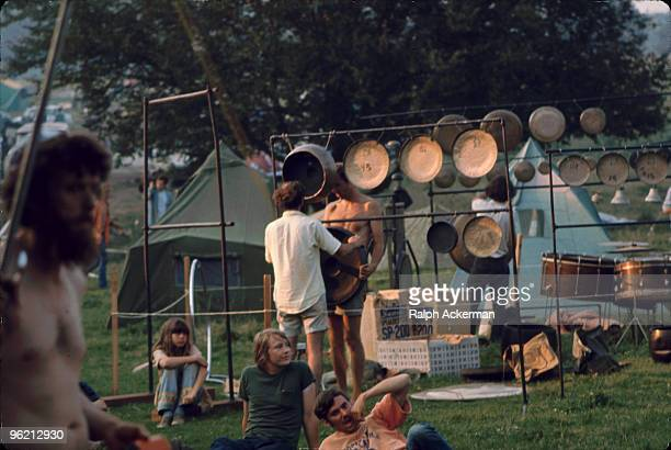 Two unidentified men arrange a series of suspended gongs near the 'Free Stage' at the Woodstock Music and Arts Fair Bethel New York August 1969 The...