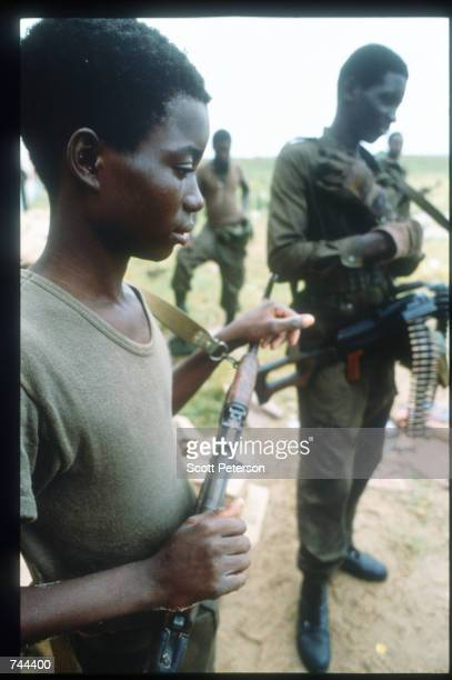 Two unidentified MPLA soldiers stand near a beach March 13 1993 in Soyo Angola State radio claims that government troops recaptured the oil town of...