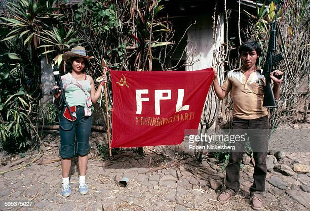 Portrait of two unidentified Popular Forces of Liberation guerrillas pose with a banner near Santa Anita Chalatenango Province El Salvador February...