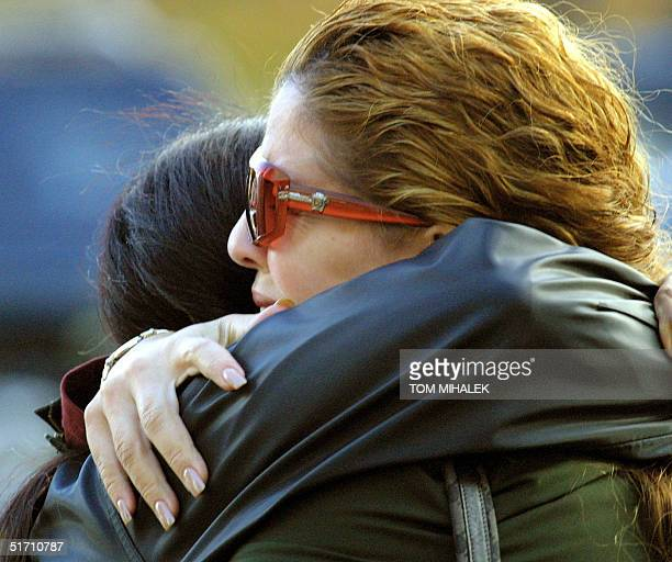Two unidentified woman hold each other outside of an emergency center setup for family members of the victims aboard American Airlines Flight 587...