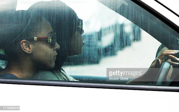Two unidentified women leave the home of New England Patriots player Aaron Hernandez in North Attleborough Mass Friday June 21 2013 Hernandez has...
