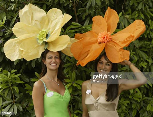 Two unidentified women sport stylish hats at opening day of Royal Ascot horse racing week June 17 2003 in Ascot England