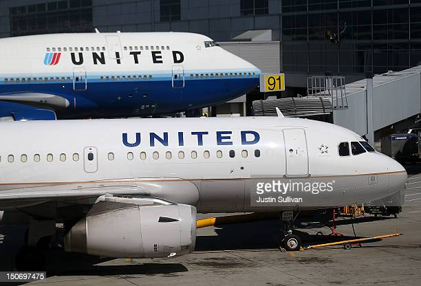 Two United Airlines planes are parked at the terminal at San Francisco International Airport on August 24 2012 in San Francisco California The...