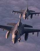 Two United States Air Forces Europe F 16C's Fly In Formation During A Mission In Support Of Nato