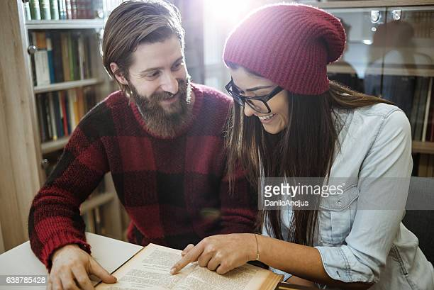 two university students studying togheter