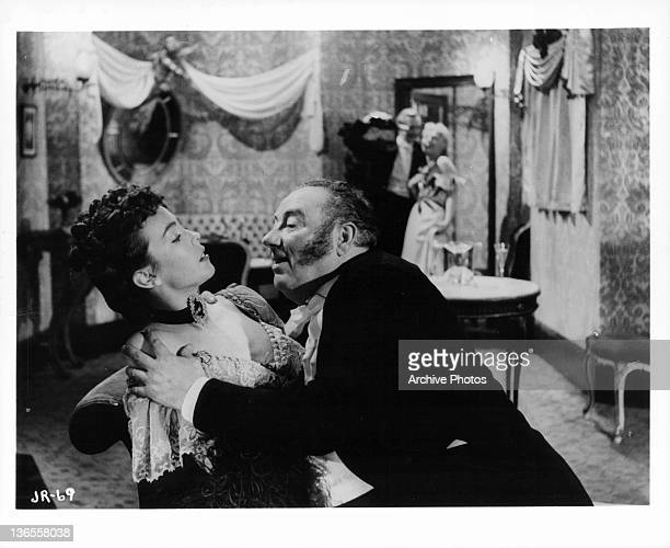 Two unknown actors in a scene from the film 'Jack The Ripper', 1959.