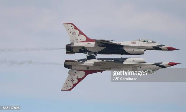 Two US Air Force F16 Thunderbirds perform during the airshow at Joint Andrews Air Base in Maryland on September 16 2017 / AFP PHOTO / ANDREW...