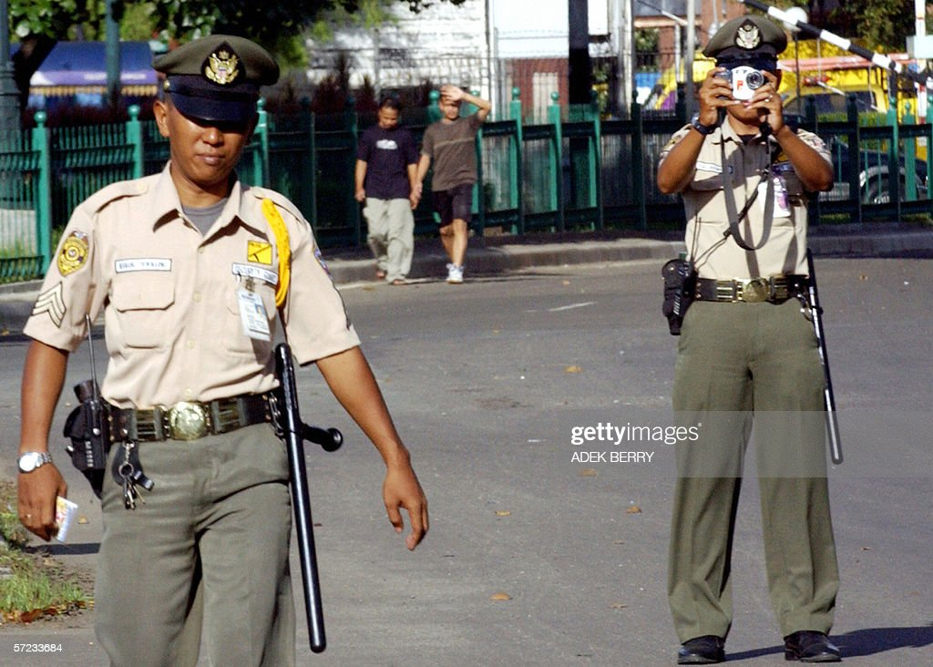 two us embassy security personnel inspect the area surrounding the embassy in jakarta 02 april