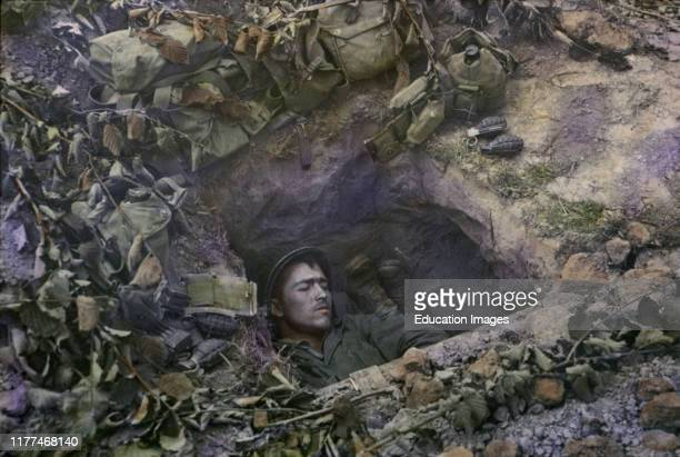 Two U.S. Infantrymen Share a Foxhole near Frontlines after the Allied Invasion of Normandy, Near Bayeux, Calvados, France, July 1944.