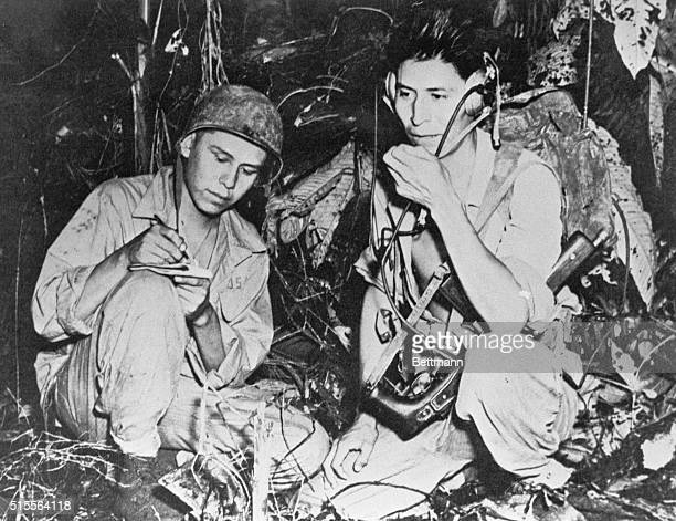 Two US Marine Navajo code talkers signalmen who used a slightly modified version of their native language send a radio signal during the battle of...