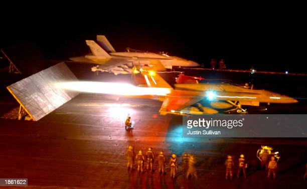 Two US Marines F/A18 Hornets launch from the flight deck of the USS Constellation as part of Operation Iraqi Freedom March 21 2003 in the Persian...