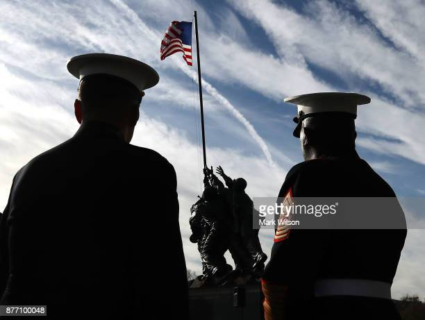 Two US Marines inspect the newly restored Iwo Jima US Marine Corps War Memorial on November 21 2017 in Arlington Virginia PhilanthropistDavid...