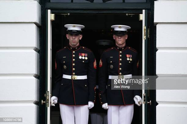 Two US Marines push open the door open for the arrival of President Andrzej Sebastian Duda of Poland at the South Portico of the White House...