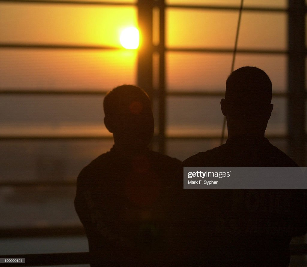 Two U.S. Marshalls patrol the concourse at Regan National Airport at sunrise on Thursday, October 4, 2001.