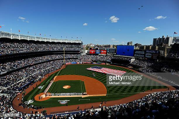 Two US Navy F18 Super Hornet Jets fly over Yankee Stadium as a giant American Flag is displayed prior to the New York Yankees home opener against the...