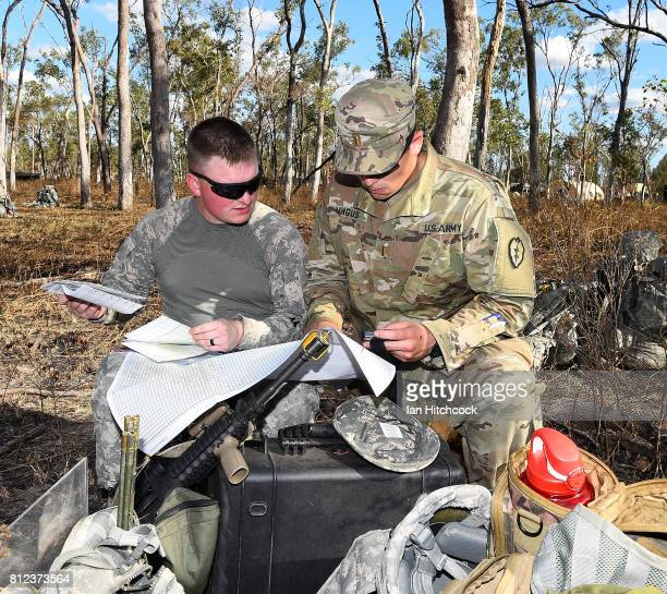 Two US soldiers from the 3rd Battlion 21st Infantry Regiment of the 1st Stryker Brigade Combat Team check a map after arriving in the Shoalwater Bay...