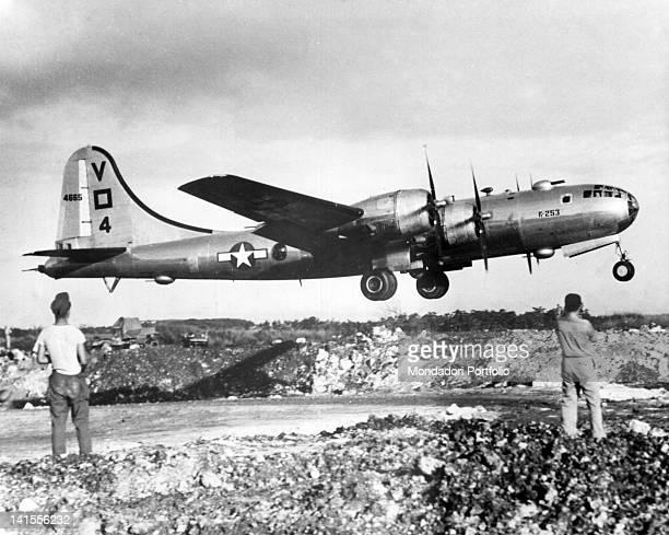Two US soldiers watching the takeoff of a B29 bomber from the air base at Saipan destination Tokyo Saipan 23rd November 1944