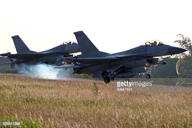 Two USmade F16 fighter jets take off from the Chiayi air force base in southern Taiwan during a demonstration on January 25 2016 International...